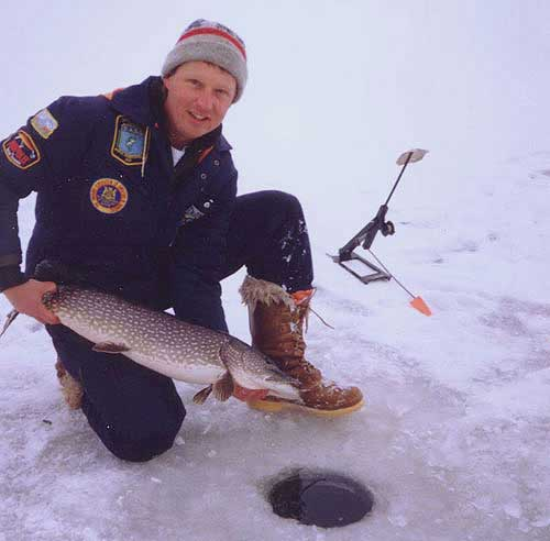 Wil with a big winter pike utilized with the two hole approach